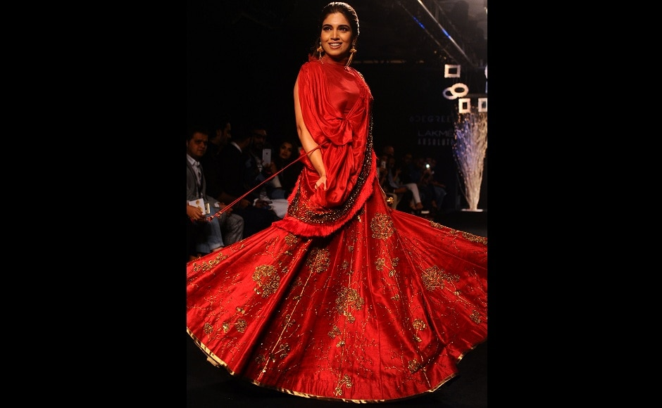 Bhumi Pednekar looked every inch of a classic, Indian bride with a modern touch, as she walked the ramp for Ruceru. Image from AFP.