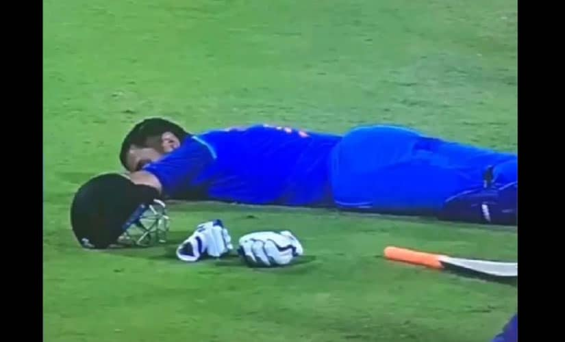 MS Dhoni takes a nap on the field during third ODI match against Sri Lanka. Youtube screen grab.