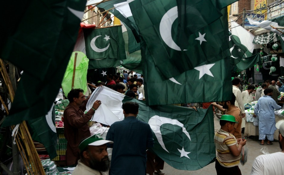 National flags are seen hanging on Pakistan's streets as it celebrates the 70th year of gaining independence from the British rule on 14 August. AP