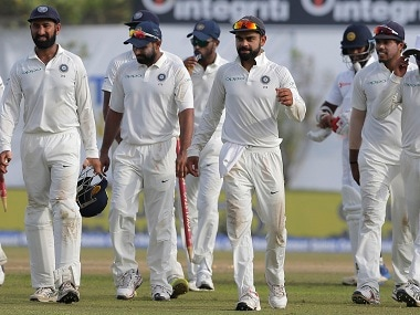 Virat Kohli leaves the ground with his teammates after their win in the first Test. AP