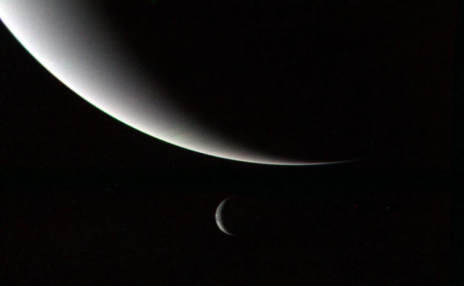 Neptune and Triton. Image: NASA.