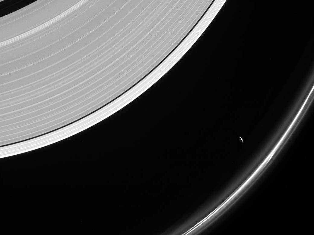 NASAs Cassini spacecraft captures an image of Saturns moon Prometheus near the F Ring