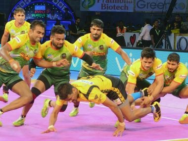 A Telugu Titans player is captures by the Patna Pirates defence. Image courtesy: Pro Kabaddi League