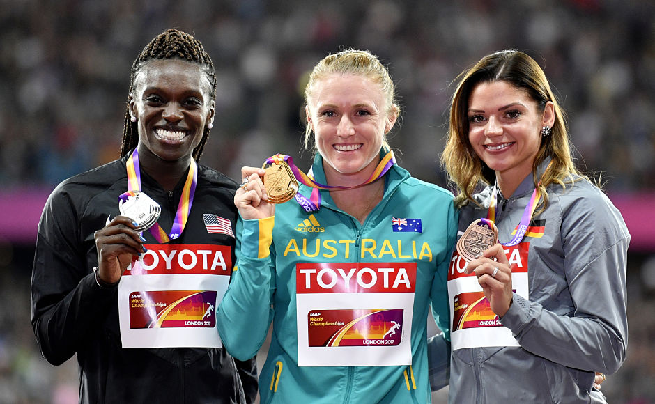 World champion in 2011 and Olympic gold medallist in 2012, Australia's Sally Pearson, centre, overcame two years of injury agony to mark her comeback with a gold in the 100m hurdles at the World Championships with a speed of 12.59 seconds as United States' Dawn Harper Nelson(L) won the silver and Germany added to its medal tally with Pamela Dutkiewicz(R) winning the bronze. AP