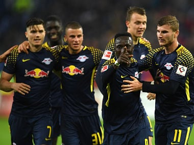 Leipzig's Guinean midfielder Naby Keita (2ndR) and his teammates celebrates after scoring during German first division Bundesliga football match between Hamburger SV and RB Leipzig in Hamburg on September 8, 2017. / AFP PHOTO / PATRIK STOLLARZ / RESTRICTIONS: DURING MATCH TIME: DFL RULES TO LIMIT THE ONLINE USAGE TO 15 PICTURES PER MATCH AND FORBID IMAGE SEQUENCES TO SIMULATE VIDEO. == RESTRICTED TO EDITORIAL USE == FOR FURTHER QUERIES PLEASE CONTACT DFL DIRECTLY AT + 49 69 650050 / RESTRICTIONS: DURING MATCH TIME: DFL RULES TO LIMIT THE ONLINE USAGE TO 15 PICTURES PER MATCH AND FORBID IMAGE SEQUENCES TO SIMULATE VIDEO. == RESTRICTED TO EDITORIAL USE == FOR FURTHER QUERIES PLEASE CONTACT DFL DIRECTLY AT + 49 69 650050