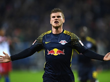 Leipzig´s striker Timo Werner celebrates after scoring during German first division Bundesliga football match between Hamburger SV and RB Leipzig in Hamburg on September 8, 2017. / AFP PHOTO / PATRIK STOLLARZ / RESTRICTIONS: DURING MATCH TIME: DFL RULES TO LIMIT THE ONLINE USAGE TO 15 PICTURES PER MATCH AND FORBID IMAGE SEQUENCES TO SIMULATE VIDEO. == RESTRICTED TO EDITORIAL USE == FOR FURTHER QUERIES PLEASE CONTACT DFL DIRECTLY AT + 49 69 650050 / RESTRICTIONS: DURING MATCH TIME: DFL RULES TO LIMIT THE ONLINE USAGE TO 15 PICTURES PER MATCH AND FORBID IMAGE SEQUENCES TO SIMULATE VIDEO. == RESTRICTED TO EDITORIAL USE == FOR FURTHER QUERIES PLEASE CONTACT DFL DIRECTLY AT + 49 69 650050