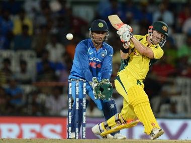 Australia's David Warner plays a shot during the 1st ODI. AFP
