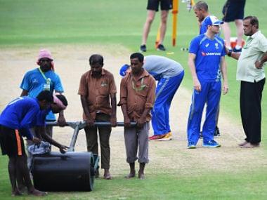 Australia's captain Steve Smith talks with Eden Gardens' pitch curator Sujan Mukherjee ahead of the 2nd ODI. AFP