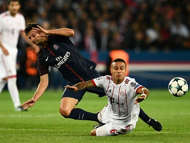 Bayern Munich's Thiago Alcantara (R) vies with Paris Saint-Germain's Thiago Motta during their UEFA Champions League match. AFP