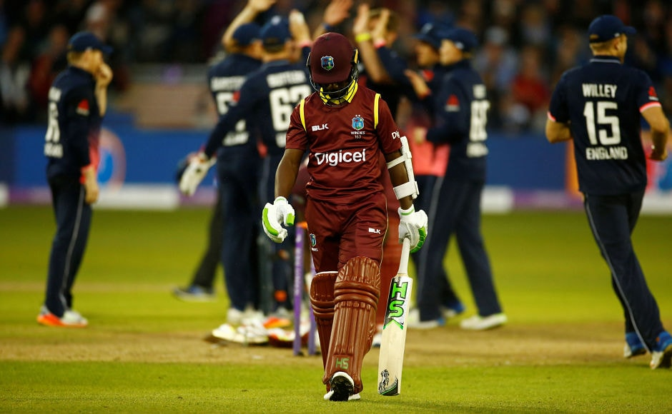 West Indies' Jason Mohammed walks off dejected after losing his wicket. Reuters