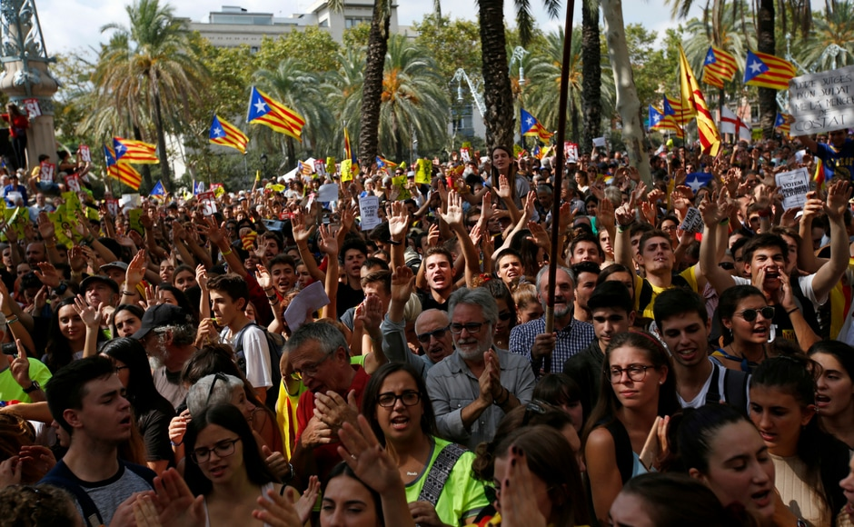 As the word about the arrests spread, the Catalan National Assembly urged people to gather at noon Thursday outside the region's justice tribunal to voice their demands. AP