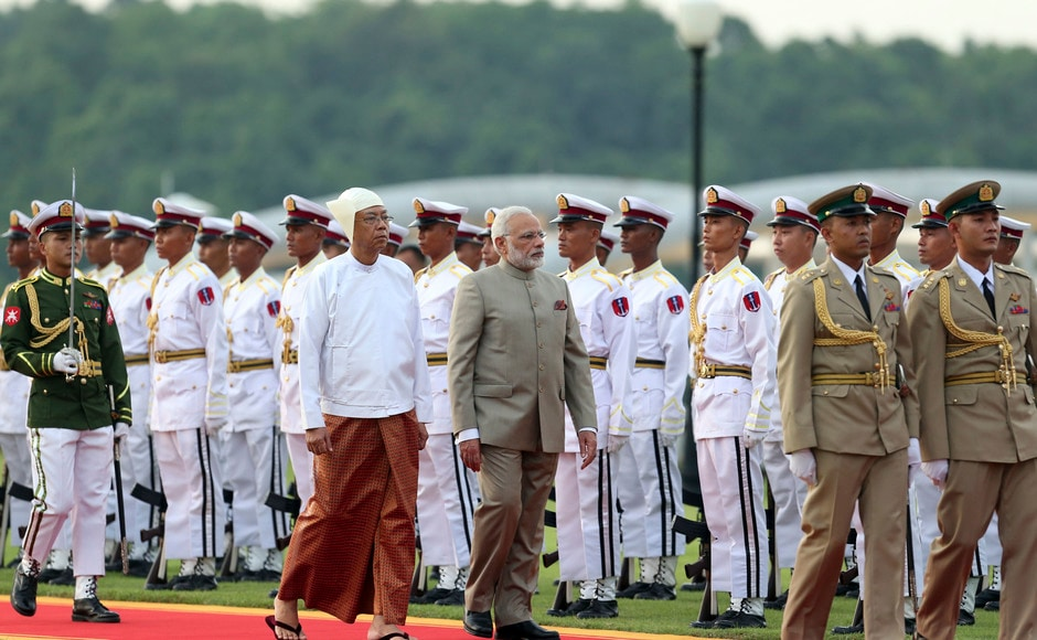 Narendra Modi arrived in Nay Pyi Taw on Tuesday on a three-day visit to Myanmar amid a raging crisis involving Rohingyas in the country's Rakhine state. Myanmar's president Htin Kyaw, accompanied Modi as they inspect the honor guard during a welcome ceremony at the Presidential Palace in Myanmar. AP