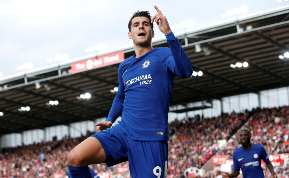 Alvaro Morata netted his first Premier League hat-trick to help Chelsea hammer Stoke City 4-0 to keep the pressure on Premier League leaders. Reuters