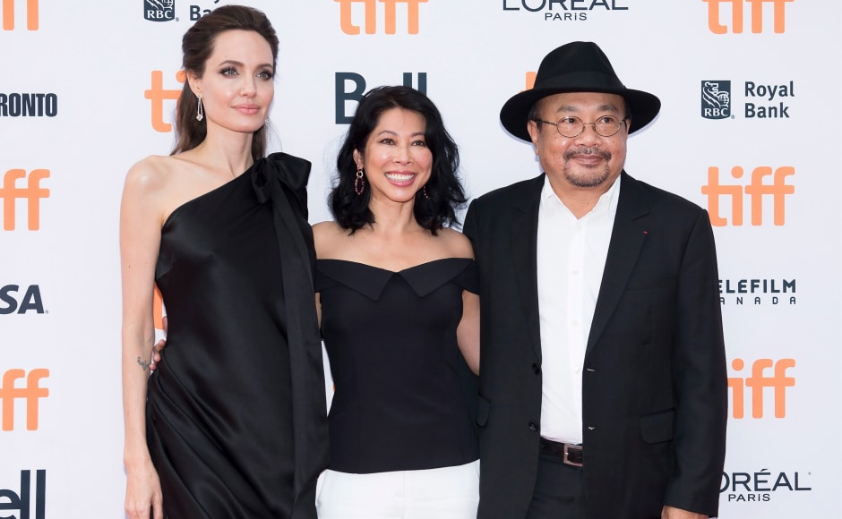 Loung Ung (centre) is the real-life inspiration behind Jolie's film.
