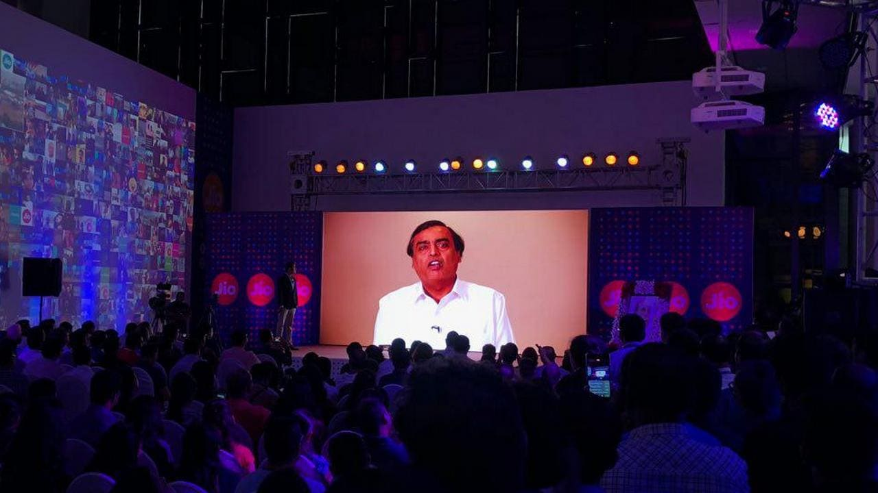 RIL Chairman Mukesh Ambani appears on a video stream at Jio's iPhone 8 launch.