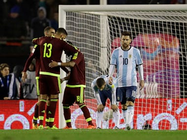 Argentina's Lionel Messi leaves the pitch as Venezuela's players celebrate at the end of a 2018 World Cup qualifying soccer match in Buenos Aires, Argentina, Tuesday, Sept. 5, 2017. The match ended 1-1.(AP Photo/Natacha Pisarenko)