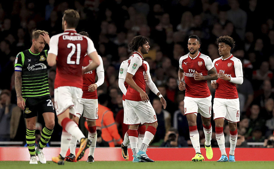 Theo Walcott was on target for Arsenal as the Gunners beat Doncaster Rovers to go through to the fourth round. AP