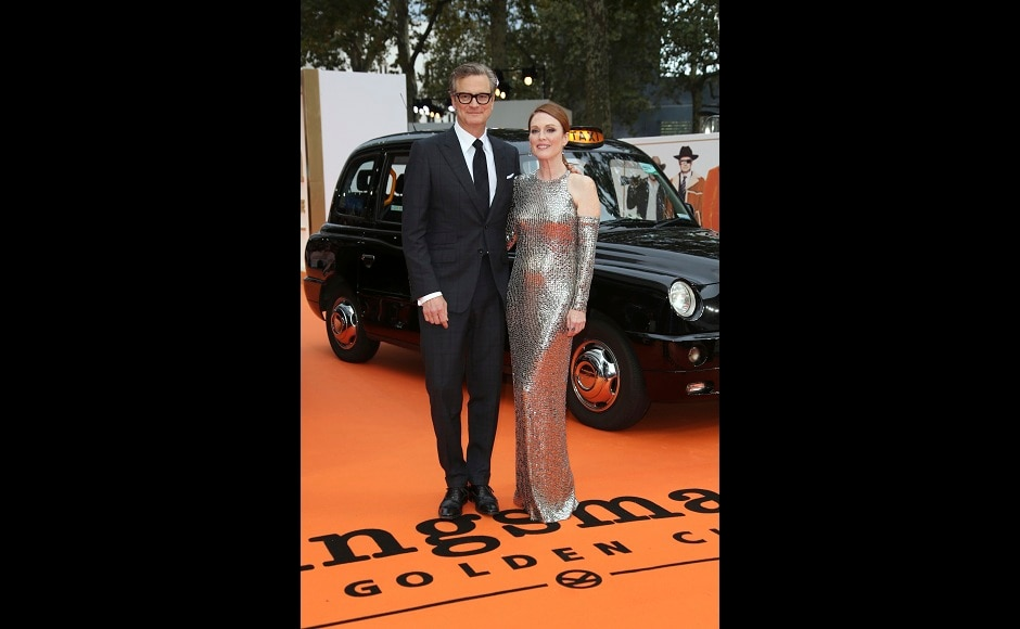 Academy Award-winning actors Colin Firth (left) and Julianne Moore pose for photographers during the premiere of the film Kingsman: The Golden Circle in London on Monday, 18 September, 2017. Photo courtesy: Joel Ryan/AP