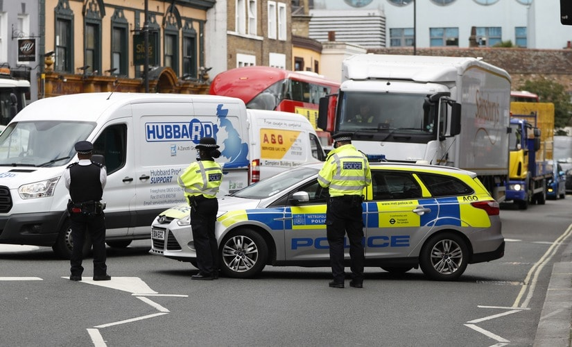 A police vehicle blocks traffic after an explosion at a train at Parsons Green subway station. AP
