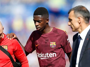 Barcelona's Ousmane Dembele leaves the pitch injured during a Spanish La Liga match against Getafe. AP