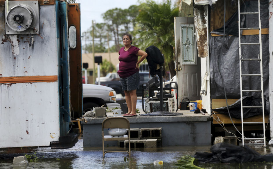 Initial estimates indicate 25 percent of the houses in Florida Keys have been destroyed, and 65 percent have received major damage. The confirmed death toll from the hurricane is 61 and still rising with 38 dead in the Caribbean and 23 in the United States. AP