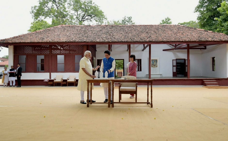 """Abe wrote a short message in Japanese – """"Love and Thanks"""" – on the visitors' log book at the ashram. The two leaders also visited the 16th century Sidi Saiyyed Ni Jaali, an ancient mosque known across the world for its intricate stone lattice work. PTI"""