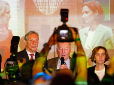 Alexander Gauland (centre), co-top candidate of the nationalist German AfD addresses reporters on Sunday. AP