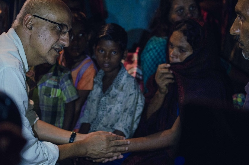 Harsh Mander, meeting the widow of Kodarbhai in a tribal village in, Sabarkantha district Gujarat