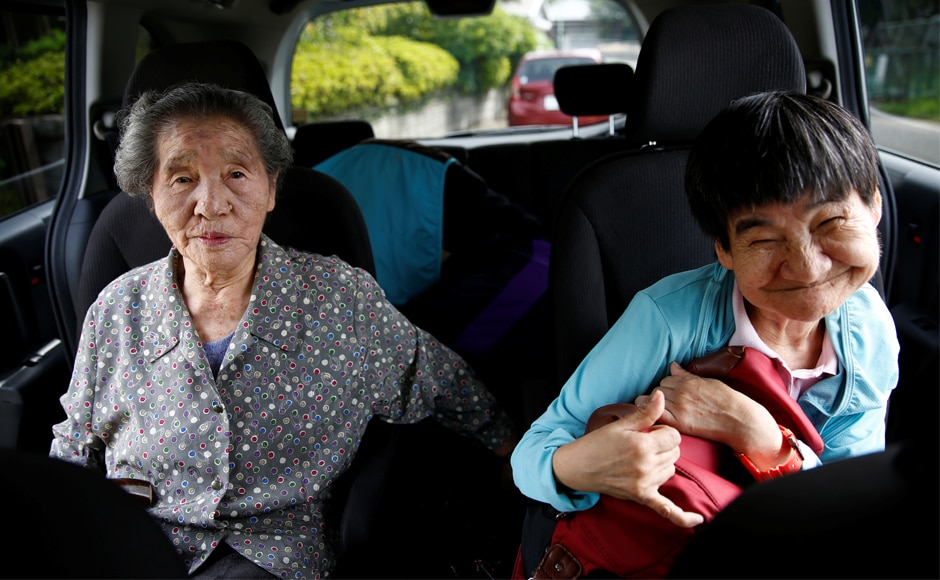 Shinobu Sakamoto, a 61-year old congenital Minamata disease patient, and her mother Fujie (left) sit in a car as they head for a hospital in Minamata, in Japan. Minamata disease is a neurological disorder caused by severe mercury poisoning.Reuters