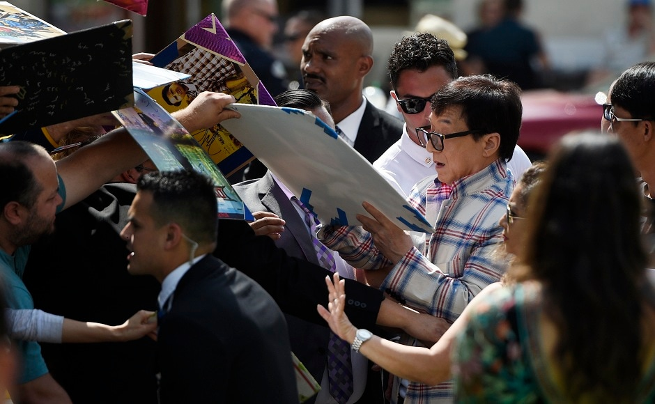 Jackie Chan (right), a cast member in The Lego Ninjago Movie, signs autographs at the premiere of the film at the Regency Village Theatre Westwood on 16 September, 2017, in Los Angeles. Photo courtesy: AP/Chris Pizzello