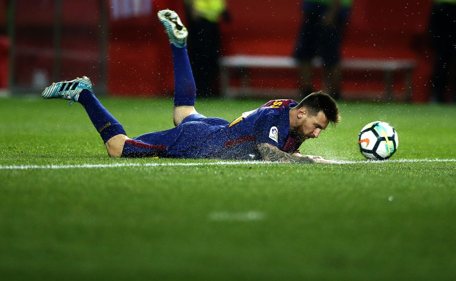 Lionel Messi falls during the La Liga match between Girona and FC Barcelona at the Montilivi stadium. Messi scored nine goals in the first five rounds of La Liga this season. AP