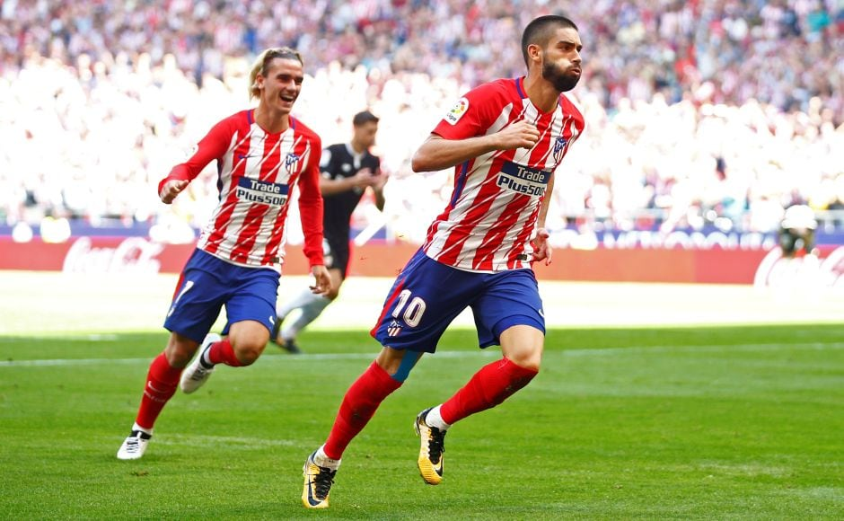 Diego Costa watched from the stands of Atletico Madrid's new Wanda Metropolitano Stadium as his soon-to-be teammates Antoine Griezmann and Yannick Carrasco scored in the second half to down Sevilla. Reuters