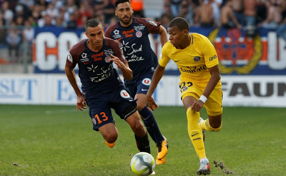 In the absence of star striker Neymar, Paris Saint-Germain dropped their first points this Ligue 1 season in a 0-0 draw at Montpellier on Saturday. PSG's Kylian Mbappe is seen in action. Reuters