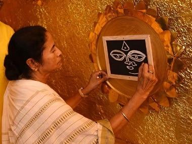 Mamata Banerjee inaugurating a Durga Puja pandal in Kolkata. Image courtesy: Twitter/@MamataOfficial