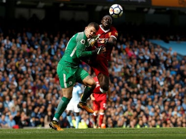 Manchester City's Ederson Moraes is fouled by Liverpool's Sadio Mane resulting in a red card for Mane. Reuters