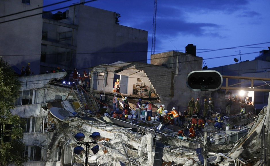 Mexico waited anxiously for signs of life in the rubble of collapsed buildings as a desperate search for survivors of a devastating earthquake entered a fourth day. AP
