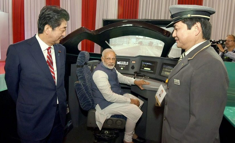 Prime Minister Narendra Modi with his Japanese counterpart, Shinzo Abe during their visit to an exhibition at Mahatma Mandir, in Gandhinagar on Thursday. PTI