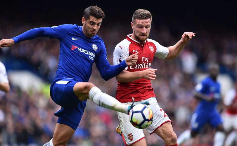 Chelsea's in-form striker Alvaro Morata was shackled by the back three of Arsenal with Shkodran Mustafi being the pick of the defenders. AFP