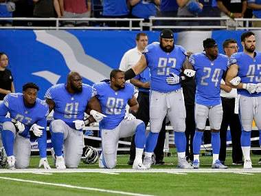President Donald Trump says feud with NFL players protesting during national anthem has nothing to do with race