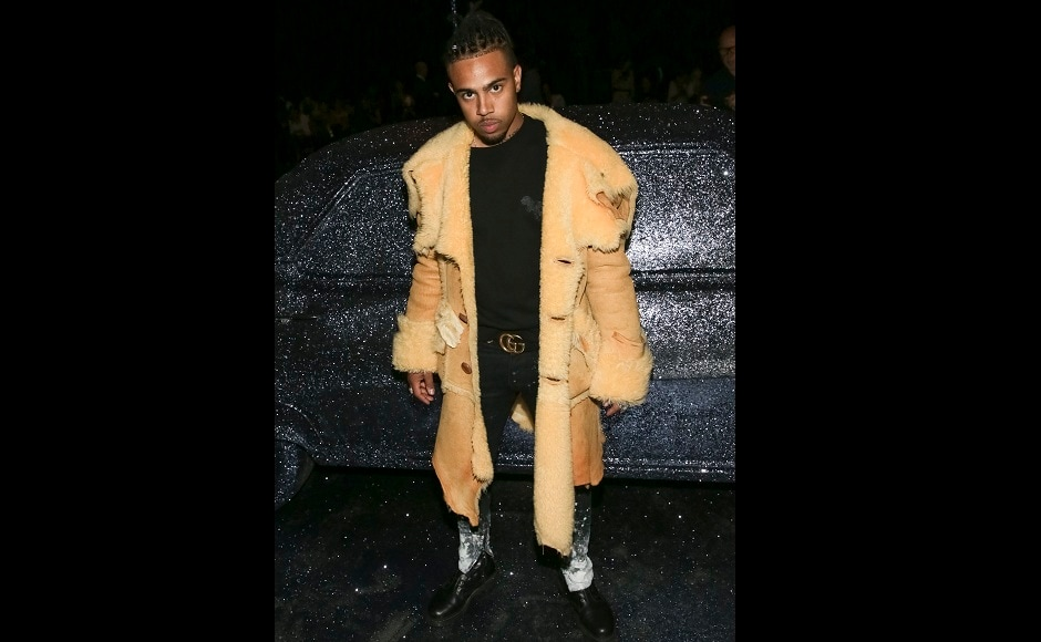 Rapper Vic Mensa also attended the show, dressed in black and yellow. Image from AP.