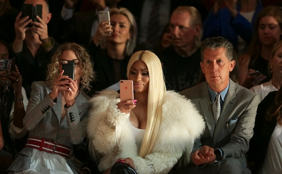 Jaime King (from left) Nicki Minaj and Stefano Tonchi click pictures on their mobile phones during theMonse 2018 Spring/Summer Presentation in New York. Photo by Brent N. Clarke/Invision/AP