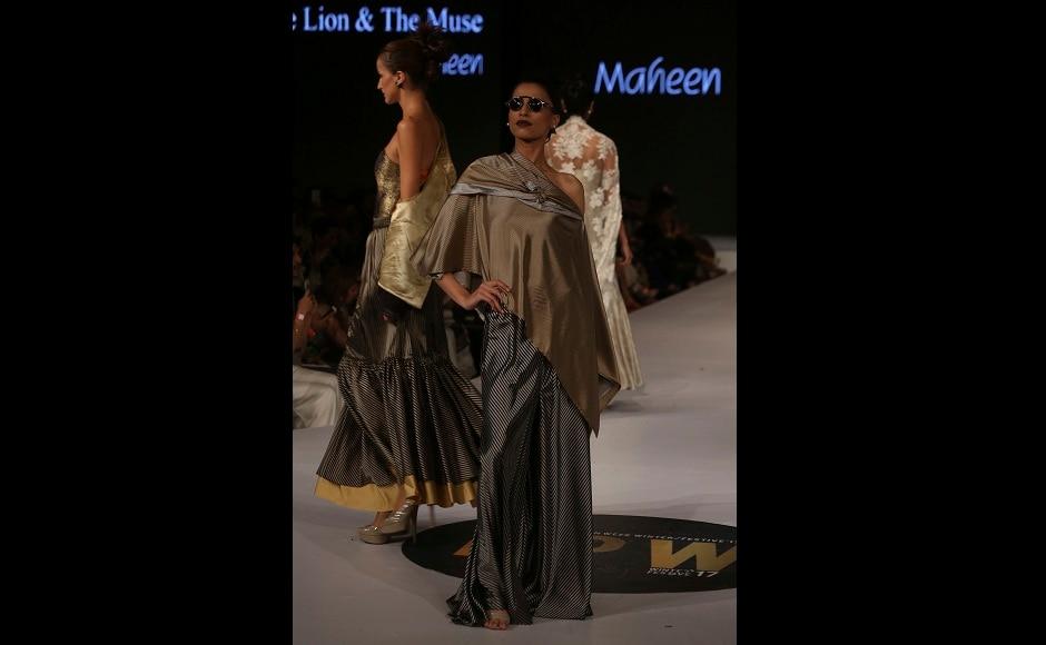 Models present creations by designer Maheen Khan during the Pakistan Spring/Summer 2017 Fashion Show Week in Karachi, Pakistan on Thursday, 14 September, 2017. Image courtesy: AP/Shakil Adil