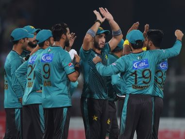 Pakistani cricketers celebrate during the third Twenty20 international match against the World XI. AP