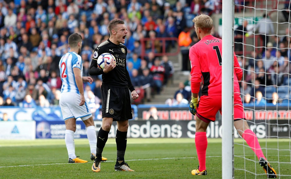 Jamie Vardy's penalty gave Leicester City a point at Huddersfield Town. Reuters