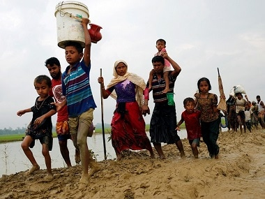 Rohingya refugees crossing the Myanmar-Bangladesh border. Reuters
