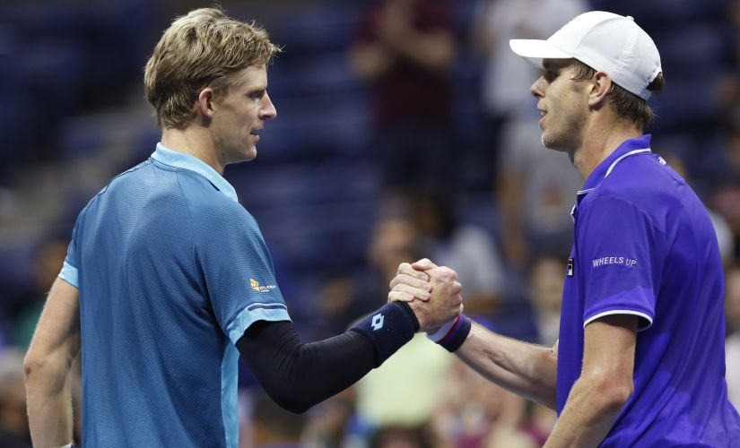 Sam Querrey, of the United States, right, congratulates Kevin Anderson, of South Africa,after Anderson upset him in a quarterfinal match at the U.S. Open tennis tournament in New York, Wednesday, Sept. 6, 2017. (AP Photo/Kathy Willens)