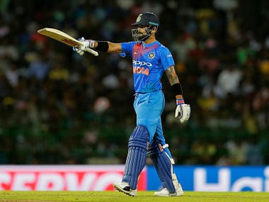 India's captain Virat Kohli raises his bat after scoring a half century during the only T20 against Sri Lanka. AP