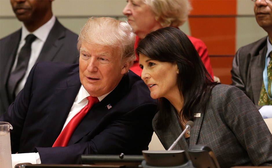 Donald Trump with US ambassador to UN Nikki Haley on Monday. In his first appearance at the UN, Trump warned bureaucracy was holding back the institution from working effectively. AP