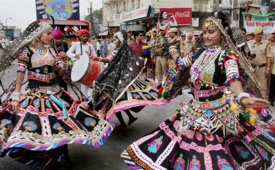 Navratri, the celebration of triumph of good over evil under Hindu mythology, started on Thursday with people across India commemorating the 9-day-long festival. Artists perform during a procession on the occasion of the first day of the festival at Katra in Jammu. PTI