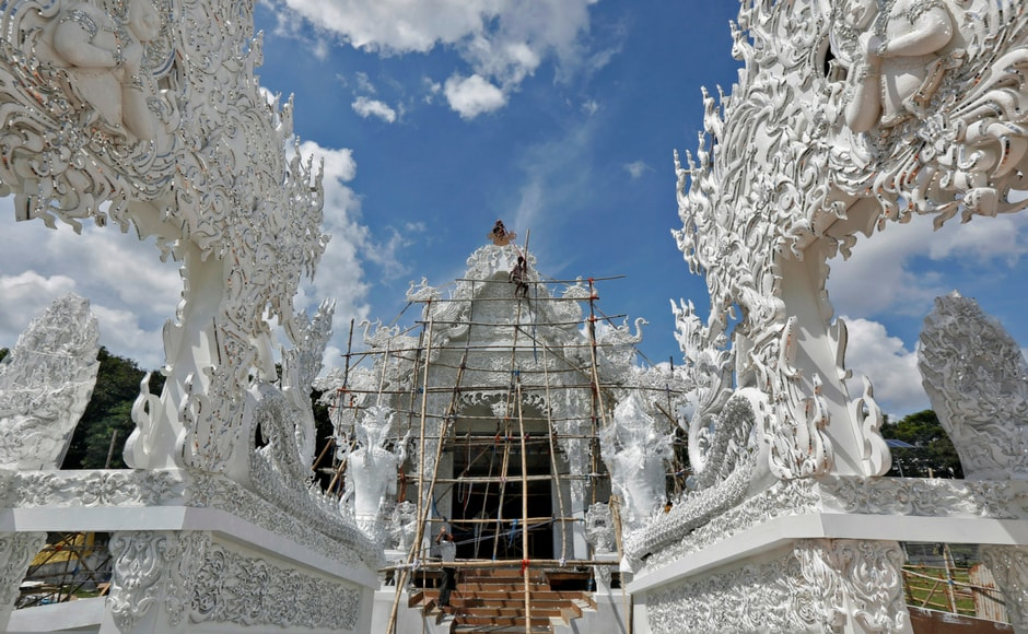 Artisans work on Kolkata's Deshapriya Park pandal. The festival will be celebrated from 26 to 30 September and heralds the victory of good over evil. Reuters